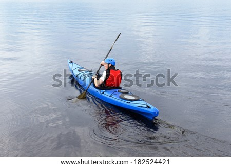 Young man kayaking. Sports and recreation