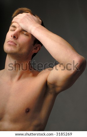 Young  man keeps  hand for  forehead,  headache, color