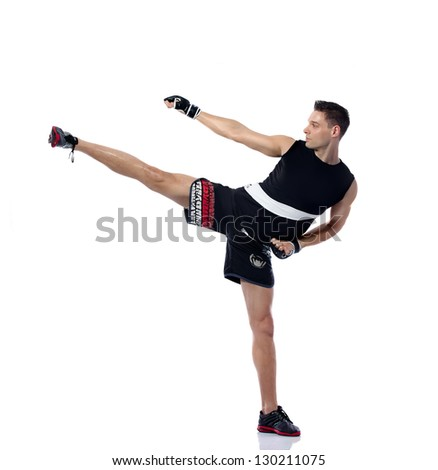 Young man kicking practicing body combat - stock photo