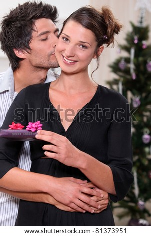 young man kissing his fiancee - stock photo