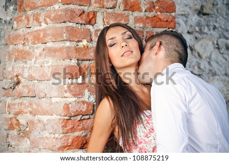 Young man kissing his lover's neck - stock photo