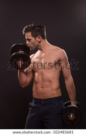 young man kissing loving weights fitness body building fit slim abs muscle
