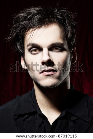 Young man, later becoming a vampire - stock photo