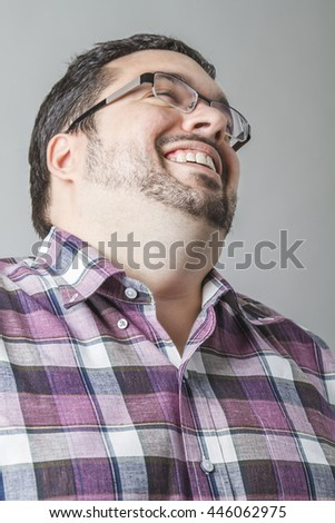 Young man laughing his head off