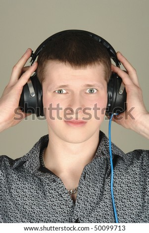 young man listening a bad music - stock photo