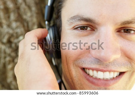 Young man listening music - stock photo