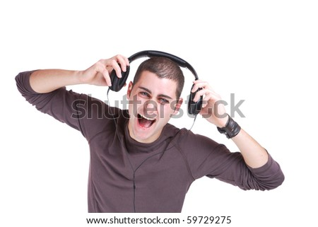 Young man listening music isolated on white - stock photo