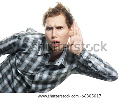 young man listening over white - stock photo