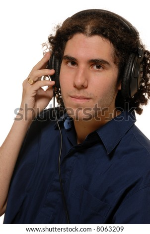young man listening to headphones, isolated on white