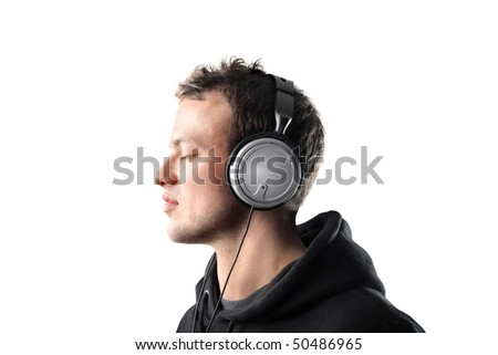 Young man listening to music - stock photo