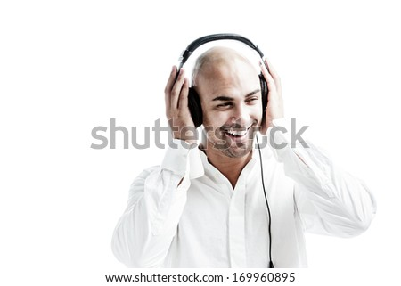 Young man listening to music and puts his hands at the earphones isolated on white - stock photo