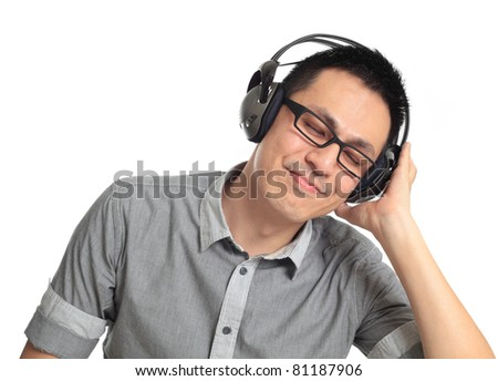 Young man listening to music. Isolated on white background. - stock photo