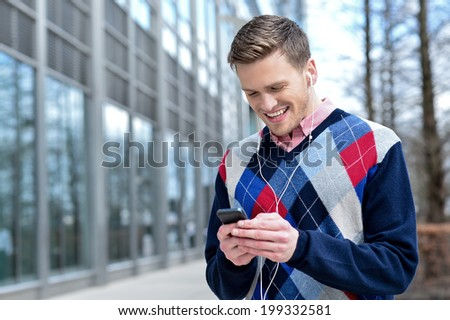 Young man listening to music on phone - stock photo