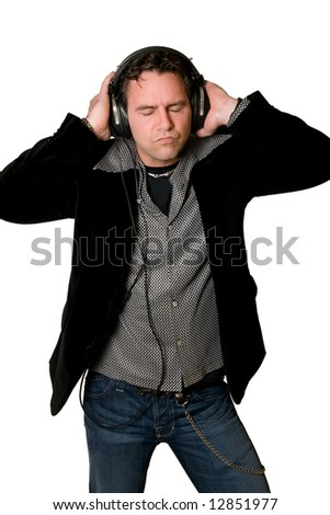 Young man listening to music wearing headphones isolated on white