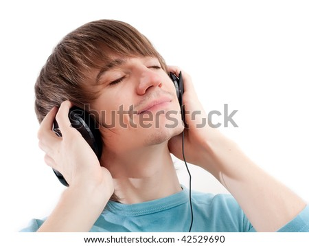 Young man listening to music with headphones. Eyes closed - stock photo