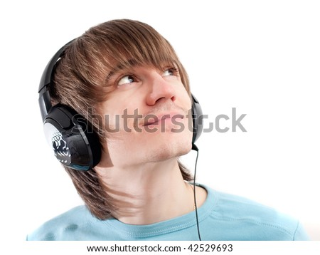 Young man listening to music with headphones. White background - stock photo