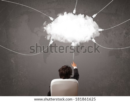 Young man looking at cloud transfer world service concept - stock photo