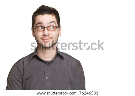 Young man looking at copyspace having a surprised or satisfied look isolated on white background - stock photo