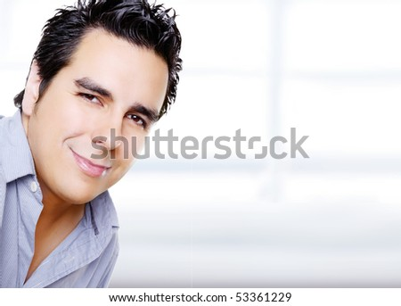 Young man looking at the camera on an empty background, to insert text or design - stock photo