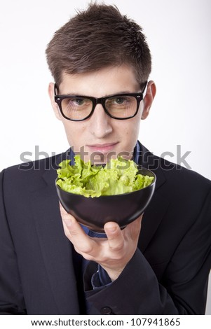 Young man looking at the salad. - stock photo