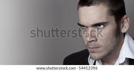 Young man looking defiant. - stock photo