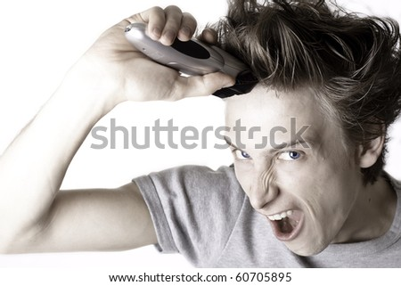 Young man looking exteremly exited going to shave his long hair - stock photo
