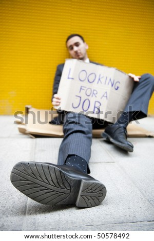 Young man looking for a job - stock photo
