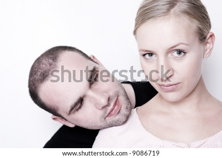 Young man looking on a girl over her shoulder. - stock photo