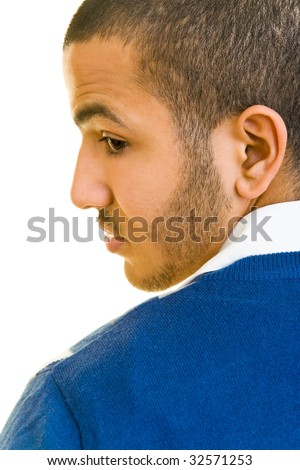 Young man looking over his shoulder - stock photo