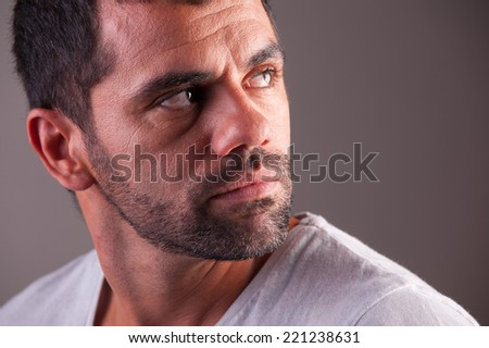 young man looking scared - stock photo