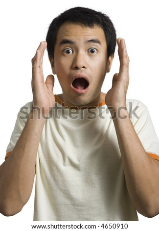 Young man looking surprised over white background - stock photo