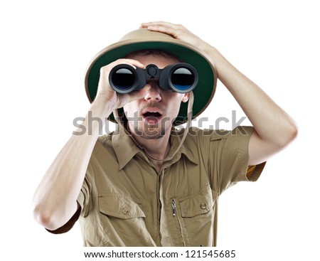 Young man looking through binoculars with an amazed expression, isolated on white - stock photo