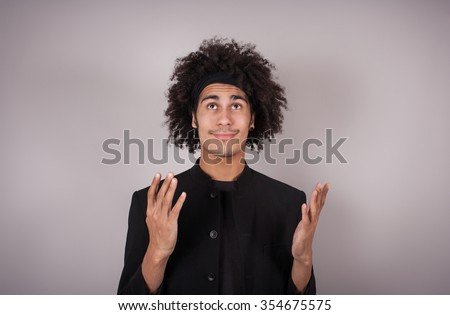 Young man looking up complaining and talking with God - stock photo