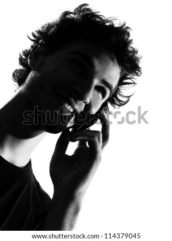 young man looking up telephone smiling portrait silhouette in studio isolated on white background - stock photo