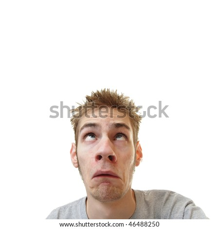 Young man looking upward overhead with a scared frown on his face isolated on white square background with room for your text - stock photo