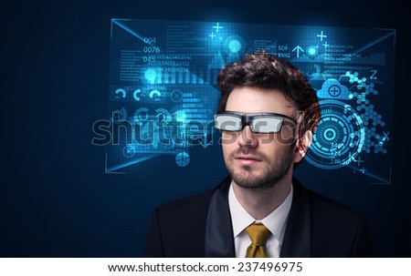 Young man looking with futuristic smart high tech glasses concept - stock photo