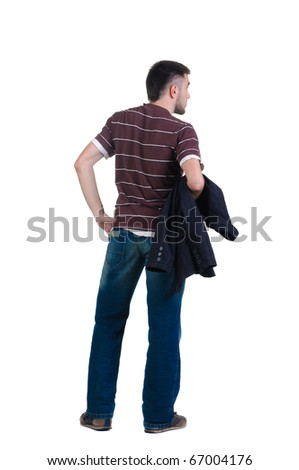 young man looks ahead. rear view. Isolated over white . - stock photo