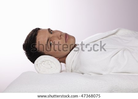 Young Man Lying in the Spa - stock photo