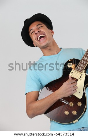 Young man M?tis playing electric guitar