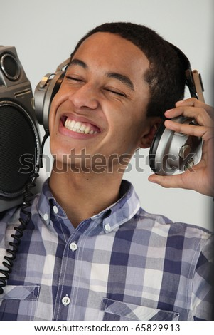 Young man M?tis smiling with headphones - stock photo