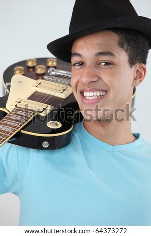 Young man M?tis with electric guitar - stock photo