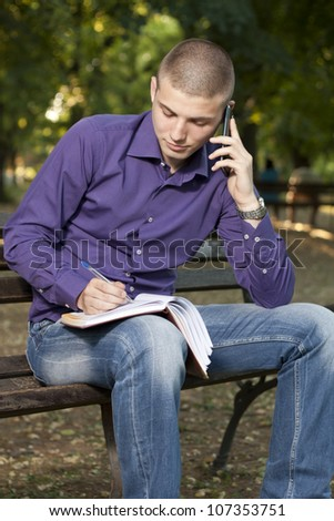 Young man makes a phone call - stock photo