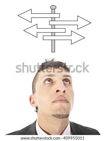 Young man making a choice with arrows isolated on white background - stock photo