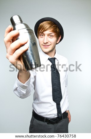 young man making cocktails - stock photo