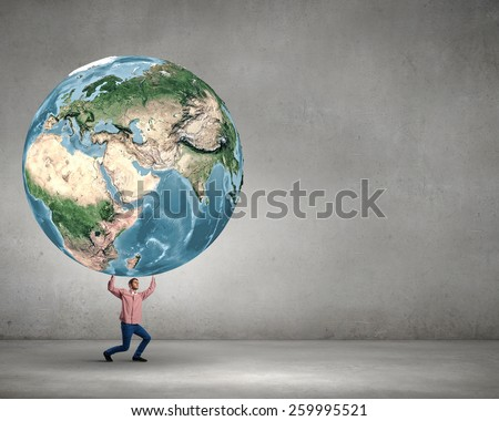 Young man making effort to lift Earth planet above head. Elements of this image are furnished by NASA - stock photo