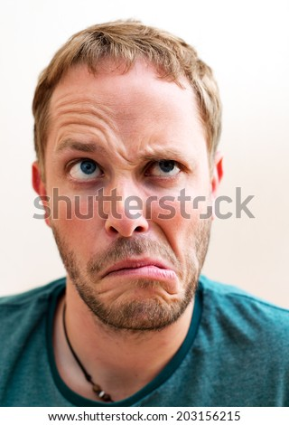 young man making grimace - stock photo