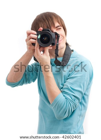 Young man making photo with professional camera.  Front view. Over white - stock photo