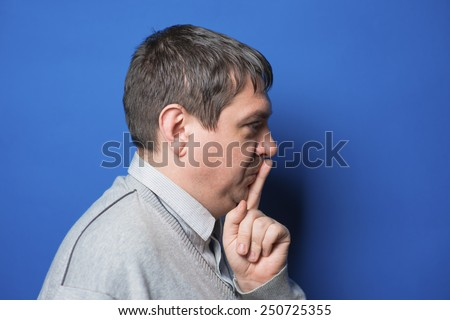 young man making silence gesture, shhh!! - stock photo