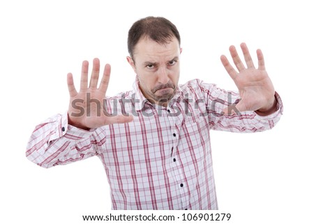 young man making stop with his hands, isolated - stock photo