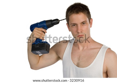 Young man making suicide with cordless drill isolated on white background
